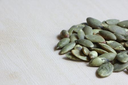pumkin: Pumkin Seeds on Wood Background.