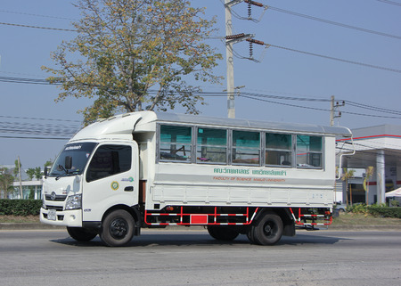 CHIANGMAI, THAILAND -JANUARY 30 2015:  School bus truck of Maejo University. Photo at road no.1001 about 8 km from city center, thailand. Editorial