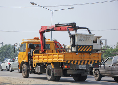 CHIANGMAI, THAILAND -FEBRUARY 2 2015: Bucket truck of Department of Highways. Photo at road no.1001 about 8 km from downtown Chiangmai, thailand.
