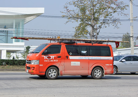 tot: CHIANGMAI, THAILAND -FEBRUARY 2 2015:   Van of Tot company. Intenet and Telephone Service in Thailand. Photo at road no 1001 about 8 km from downtown Chiangmai, thailand. Editorial
