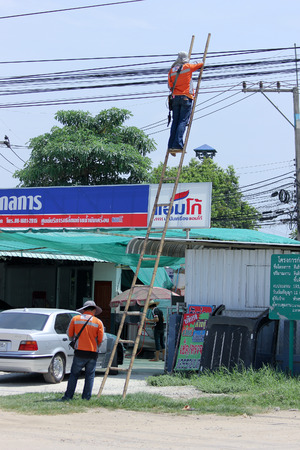 hi speed: CHIANGMAI THAILAND  JUNE 4 2015:  Engineer of Triple T Boardband Internet 3BB Check signal of Hi speed Intternet. Photo at road no.121 about 8 km from downtown Chiangmai thailand.