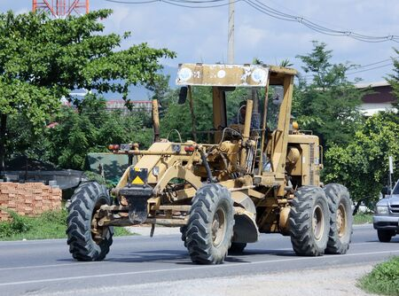 grader: CHIANGMAI  THAILAND JUNE 3 2015:  Private Catterpillaer Road grader. Photo at road no.1001 about 8 km from downtown Chiangmai thailand.