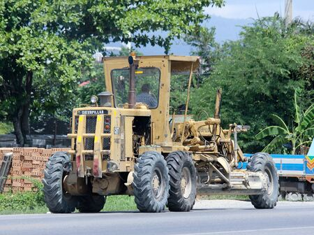 CHIANGMAI  THAILAND JUNE 3 2015:  Private Catterpillaer Road grader. Photo at road no.1001 about 8 km from downtown Chiangmai thailand.