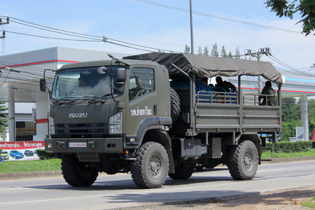 armored truck: CHIANGMAI, THAILAND -AUGUST 10 2015:   Military Isuzu truck of Royal Thai Army. Photo at road no 121 about 8 km from downtown Chiangmai, thailand.