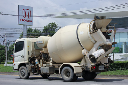 concrete truck: CHIANGMAI, THAILAND -AUGUST 13 2015:   Concrete truck of Chiangmai Concrete product company. Photo at road no.121 about 8 km from downtown Chiangmai, thailand.