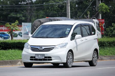 freed: CHIANGMAI, THAILAND -AUGUST 13 2015:  Private Honda Freed van. Photo at road no.121 about 8 km from downtown Chiangmai, thailand.