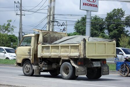 dump truck: CHIANGMAI, THAILAND -AUGUST 13 2015:  Private Yellow  Old Mitsubishi  Dump Truck. Photo at road no.121 about 8 km from downtown Chiangmai, thailand. Editorial