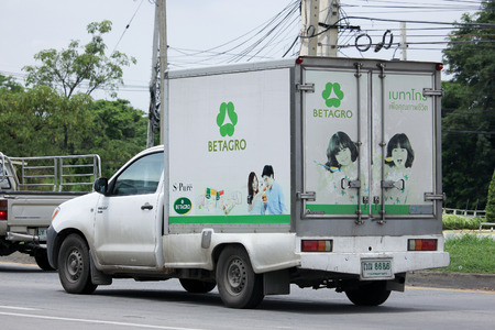 refrigerated: CHIANGMAI, THAILAND -AUGUST 13 2015: Refrigerated container Pickup truck of Betagro Company. Photo at road no 1001 about 8 km from downtown Chiangmai, thailand.