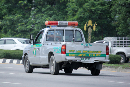 enforcement: CHIANGMAI, THAILAND -AUGUST 20 2015: Pickup truck of Chiangmai city law enforcement, Municipal Police. Photo at road no.121 about 8 km from downtown Chiangmai, thailand.