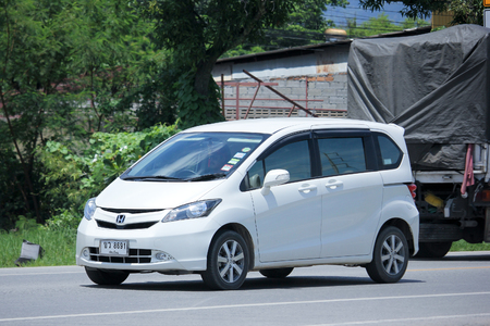 km: CHIANGMAI, THAILAND -AUGUST 21 2015:  Private Honda Freed van. Photo at road no.121 about 8 km from downtown Chiangmai, thailand. Editorial