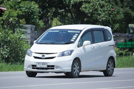 mpv: CHIANGMAI, THAILAND -AUGUST 21 2015:  Private Honda Freed van. Photo at road no.121 about 8 km from downtown Chiangmai, thailand. Editorial