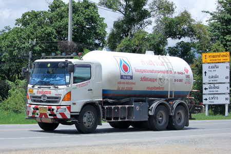 ngv: CHIANGMAI, THAILAND -AUGUST 22 2015: Chiangrai Gas supply Company Truck. For PTT LPG Gas. Photo at road no 121 about 8 km from downtown Chiangmai, thailand.
