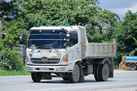 truckload: CHIANGMAI, THAILAND -AUGUST 22 2015: Pinit 6 wheel Dump Truck. Photo at road no.121 about 8 km from downtown Chiangmai, thailand.