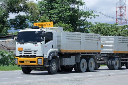 dump truck: CHIANGMAI, THAILAND -AUGUST 22 2015: Trailer dump truck of D stone company. Photo at road no 121 about 8 km from downtown Chiangmai, thailand.