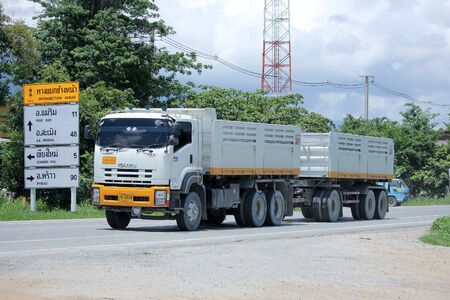 truckload: CHIANGMAI, THAILAND -AUGUST 22 2015: Trailer dump truck of D stone company. Photo at road no 121 about 8 km from downtown Chiangmai, thailand.