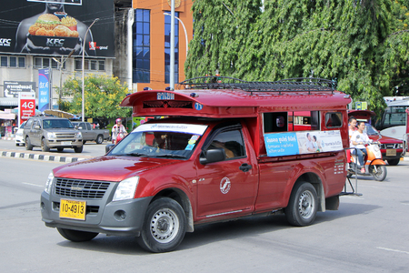 taxi: CHIANGMAI, THAILAND -SEPTEMBER 30 2015:  Red taxi Chiang Mai, For Passenger from Bus Station to City Center. Photo at Chiangmai bus station, thailand.