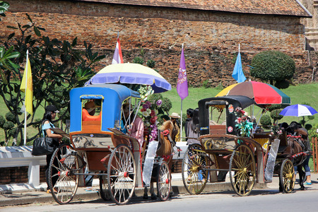 pra: LAMPANG, THAILAND -OCTOBER  21 2015: Horse carriage at Wat pra that Lampang Luang. Lanna style Buddhist temple in Lampang Province, Thailand.