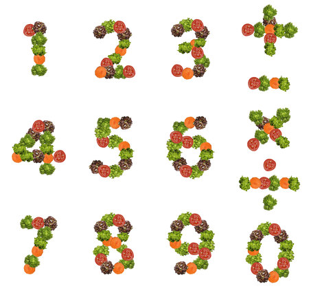 in number: Number made from fresh tomato salad and carrot. Stock Photo