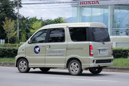 CHIANGMAI, THAILAND -SEPTEMBER  6 2015:  Mini Tongfong van of VA Tours and Travel. Photo at road no 1001 about 8 km from downtown Chiangmai, thailand.