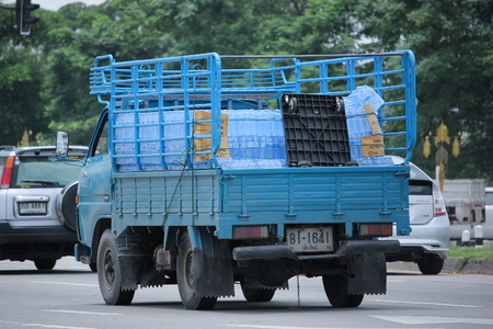 water transportation: CHIANGMAI, THAILAND -SEPTEMBER  7 2015:  Drinking water delivery truck of Glacier company. Photo at road no.121 about 8 km from downtown Chiangmai, thailand. Editorial