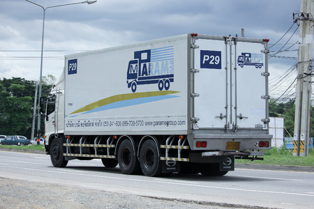 loading truck: CHIANGMAI, THAILAND -SEPTEMBER  7 2015:  Container truck of Parame Logistics Transportation company. Photo at road no.121 about 8 km from downtown Chiangmai, thailand.