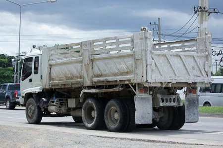 truckload: CHIANGMAI, THAILAND -SEPTEMBER  7 2015:  Dump Truck of Payawan Transport Company. Photo at road no.121 about 8 km from downtown Chiangmai, thailand. Editorial