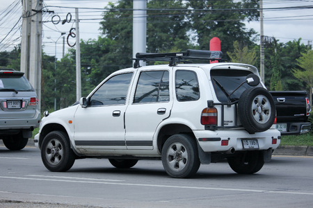 mpv: CHIANGMAI, THAILAND -SEPTEMBER  8 2015:   Private MPV Car, Kia Sportage. Photo at road no.121 about 8 km from downtown Chiangmai, thailand.