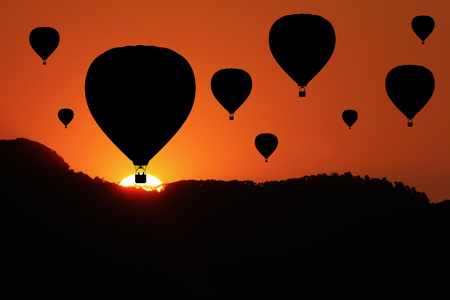 sunrise mountain: mountain and Sunrise with silhouette of hotair balloons. Stock Photo