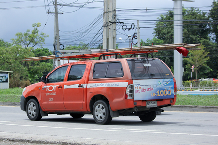 tot: CHIANGMAI, THAILAND -SEPTEMBER  10 2015:  Pickup truck of Tot company.Intenet and Telephone Service in Thailand. Photo at road no.121 about 8 km from downtown Chiangmai, thailand.