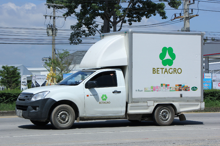 refrigerated: CHIANGMAI, THAILAND -SEPTEMBER  22 2015:  Refrigerated container Pickup truck of Betagro Company. Photo at road no 1001 about 8 km from downtown Chiangmai, thailand.