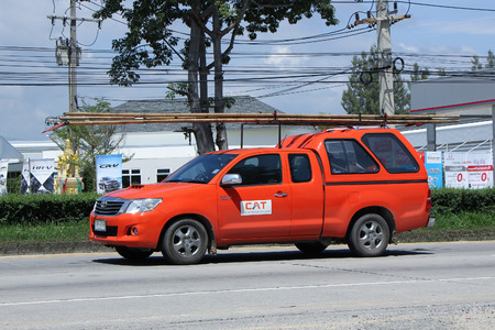 public company: CHIANGMAI, THAILAND -SEPTEMBER  22 2015:   Pickup truck of CAT Telecom Public Company Limited. Intenet and Telephone Service in Thailand. Photo at road no 121 about 8 km from downtown Chiangmai, thailand. Editorial