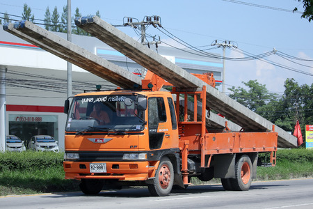 phon: CHIANGMAI, THAILAND -SEPTEMBER  28 2015:  Truck with Crane of Khun Phon SG Eletricity Service. Photo at road no.1001 about 8 km from downtown Chiangmai, Thailand. Editorial