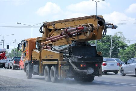concrete pump: CHIANGMAI, THAILAND -SEPTEMBER  28 2015:  CONCRETE PUMP Line Truck of INSEE Concrete company. Photo at road no 121 about 8 km from downtown Chiangmai, thailand.