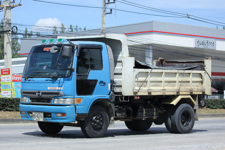 truckload: CHIANGMAI, THAILAND -OCTOBER  8 2015:  Private Hino Dump Truck. Photo at road no.1001 about 8 km from downtown Chiangmai, thailand.
