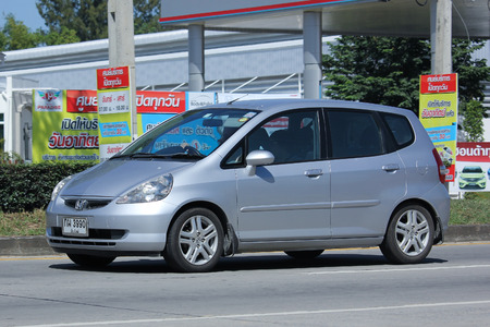 automobile door: CHIANGMAI, THAILAND -OCTOBER  15 2015:  Private Honda Jazz Car, Five door hatchback automobile.  Photo at road no.1001 about 8 km from downtown Chiangmai, thailand. Editorial