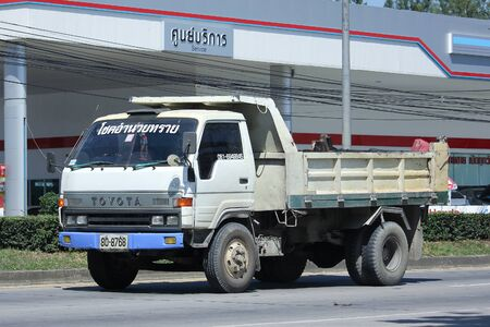 highway 6: CHIANGMAI, THAILAND -OCTOBER  20 2015:  Choke Amnuay Sray 6 wheel Dump Truck. Photo at road no.121 about 8 km from downtown Chiangmai, thailand.