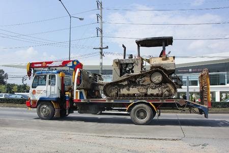 truckload: CHIANGMAI, THAILAND -OCTOBER  24 2015:  Truck for move bachole of Payawan company.  Photo at road no.121 about 8 km from downtown Chiangmai, thailand.