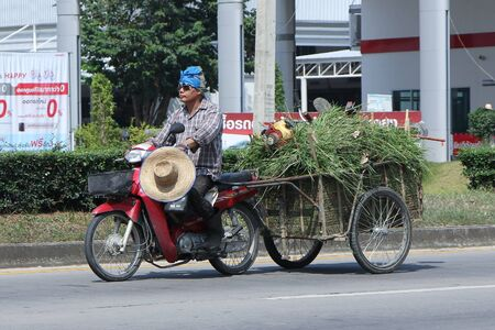 motobike: CHIANGMAI, THAILAND -OCTOBER  24 2015:  Private Honda Motorcycle with Trailer. Photo at road no.121 about 8 km from downtown Chiangmai, thailand.