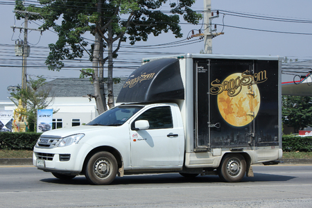 public company: CHIANGMAI, THAILAND -OCTOBER  26 2015:  Truck of Sangsom product, Thai Beverage Public Company Limited. Photo at road no 121 about 8 km from downtown Chiangmai, thailand.