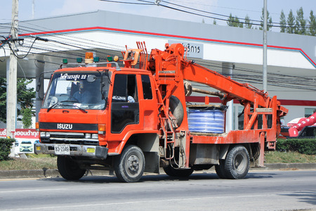crane bucket: CHIANGMAI, THAILAND -OCTOBER  29 2015:  Truck of Provincial eletricity Authority of Thailands. Photo at road no.1001 about 8 km from downtown Chiangmai, thailand.