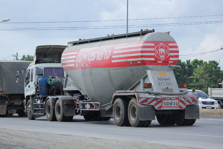 materiales de construccion: CHIANGMAI, THAILAND -NOVEMBER  3 2015:  Cement truck of Tib Phipat company. Photo at road no.1001 about 8 km from city center, thailand.
