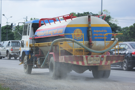 wetting: CHIANGMAI, THAILAND -NOVEMBER  3 2015: Payawan  water Truck. Photo at Road No.121 about 8 Km from Chiangmai city.