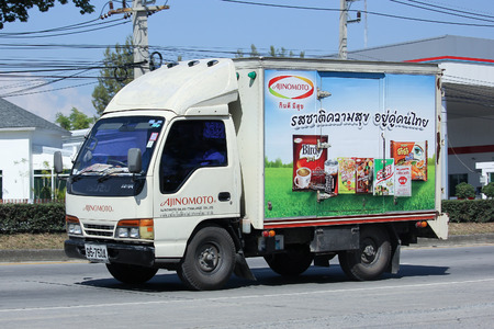 milk products: CHIANGMAI, THAILAND -NOVEMBER 5 2015:  Container truck of Ajinomoto sale thailand company. Photo at road no 121 about 8 km from downtown Chiangmai, thailand. Editorial