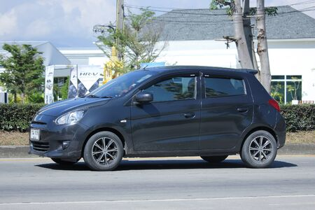 a mirage: CHIANGMAI, THAILAND -NOVEMBER 5 2015:  Private Mitsubishi Mirage Eco car. Photo at road no.121 about 8 km from downtown Chiangmai, thailand.