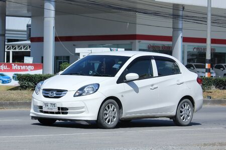 amaze: CHIANGMAI, THAILAND -NOVEMBER 5 2015:  Private Eco car, Honda Brio Amaze. Photo at road no.121 about 8 km from downtown Chiangmai, thailand.