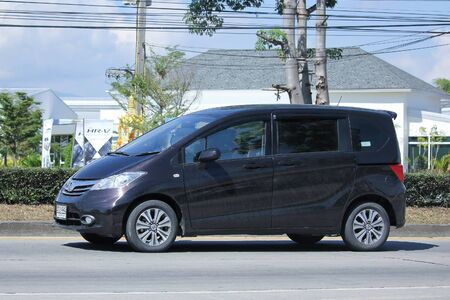 freed: CHIANGMAI, THAILAND -NOVEMBER 5 2015:  Private Honda Freed van. Photo at road no.121 about 8 km from downtown Chiangmai, thailand. Editorial