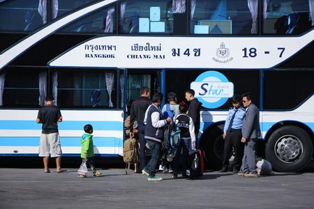 bus station: CHIANGMAI, THAILAND -JANUARY 10 2016:  Passenger of Sombattour bus  company. Route Bangkok and Chiangmai. Photo at Chiangmai bus station, thailand.