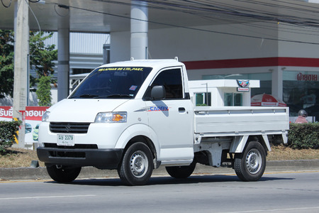 suzuki: CHIANGMAI, THAILAND -NOVEMBER 6 2015:   Private Pick up Truck, Suzuki Carry. Photo at road no 121 about 8 km from downtown Chiangmai, thailand.