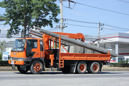 phon: CHIANGMAI, THAILAND -NOVEMBER 9 2015:  Truck with Crane of Khun Phon SG Eletricity Service. Photo at road no.1001 about 8 km from downtown Chiangmai, Thailand.