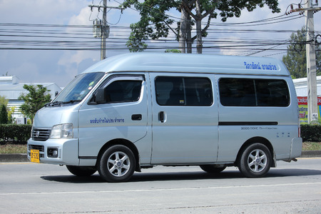 8 12: CHIANGMAI, THAILAND -NOVEMBER 12 2015:    Private Nissan Urvan Van for rent to Travel. Photo at road no.1001 about 8 km from downtown Chiangmai, thailand.
